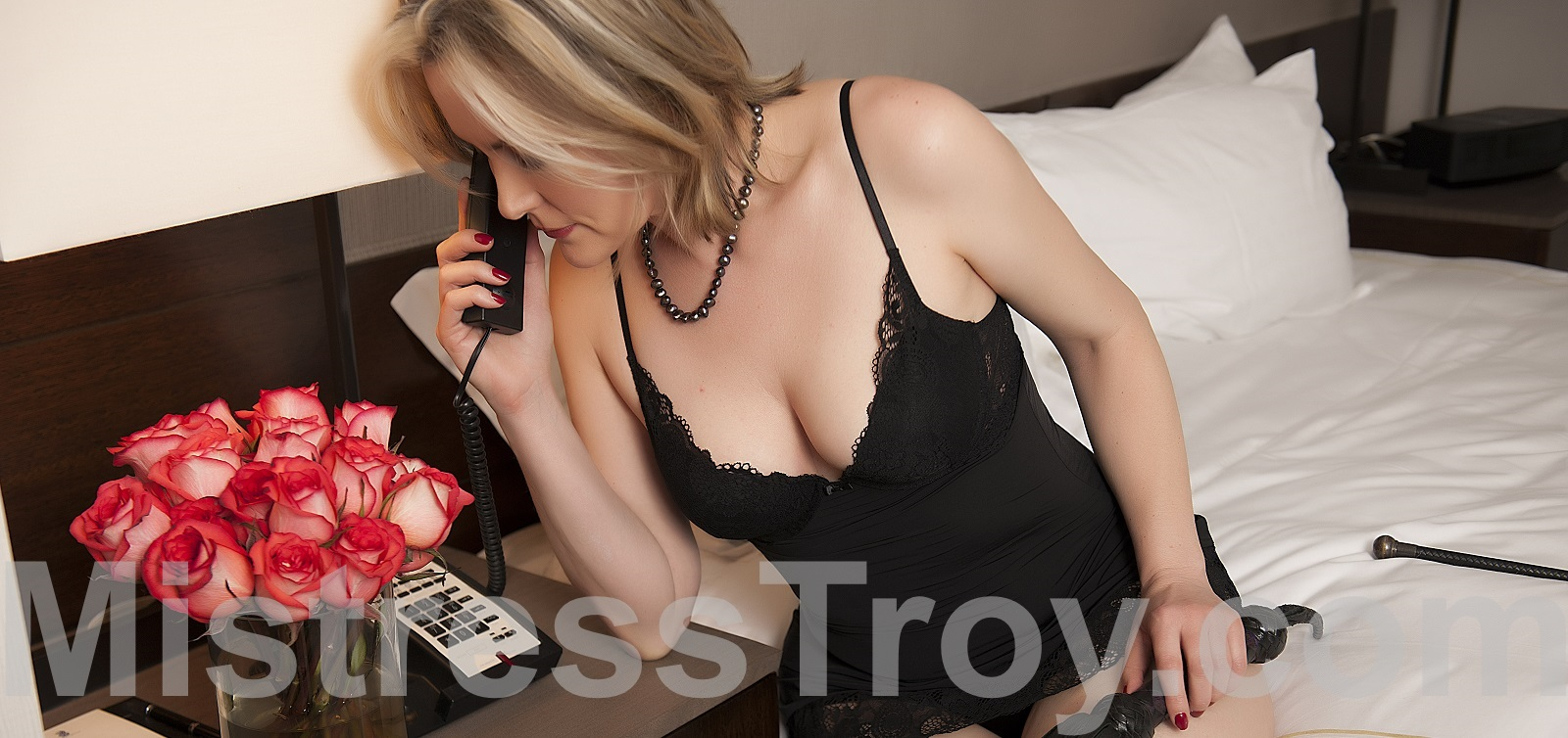 FemDomme Mistress Troy of New York NY offers phone sessions to Her male slaves and submissives