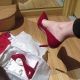 Mistress Troy tries on her new red patent leather high heel pumps