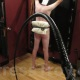 Mistress Troy prepares to use her new 4 foot 12 plait leather bullwhip made by Louie Foxx